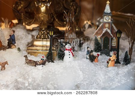 Toy Christmas Ceramic Miniature With Snow-covered City And Model Of Walking People. Small Festive Vi