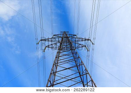 High-voltage Wires. High Voltage Post. High-voltage Tower Sky Background.
