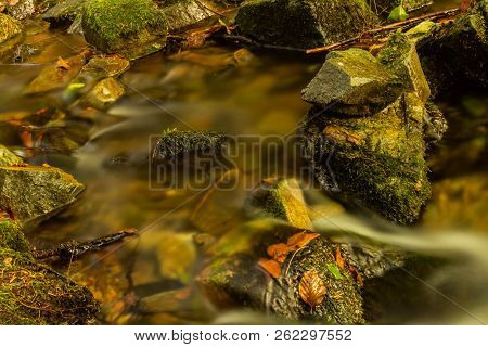 Mountain Creek Cascade With Fresh Green Moss On The Stones Long Exposure For Soft Water Look