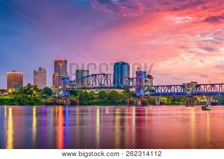 Little Rock, Arkansas, USA skyline on the Arkansas River at dusk.