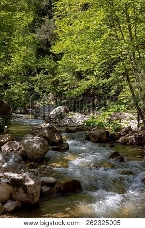 A Mountain, Cold, Fast River Flows Among Large Boulders On A Sunny, Summer Day (greece, Mountains Pi