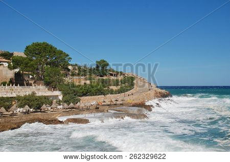 MAJORCA, SPAIN - OCTOBER 2, 2018: Stormy seas break on Molins beach at Cala San Vicente on the Spanish island of Majorca. The resort is comprised of four separate beaches.
