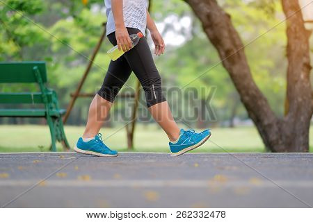 Young Fitness Woman Legs Walking In The Park Outdoor, Female Runner Running On The Road Outside, Asi