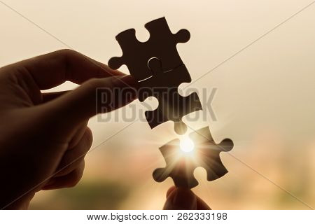 Silhouette Woman Hands Connecting Couple Puzzle Piece Against Sunrise Effect, Businesswoman Holding