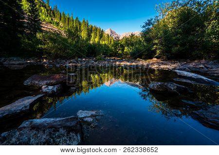 Pond Reflections Of Natural Beauty In The Rocky Mountains. Aspen , Colorado Maroon Bells Wilderness