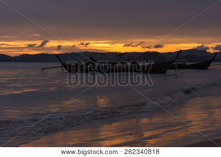 Twilight View Of Waves And Boats
