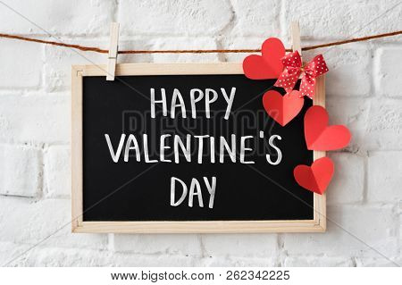 Text Happy Valentine's Day written on a blackboard