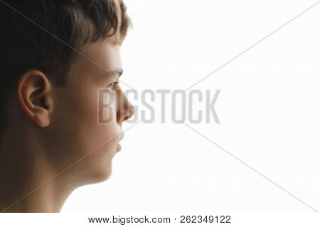 Teen face in profile on white