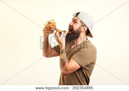 Happy Hungry Man Eating Pizza From A Box Isolated On White Background. Handsome Sexy Bearded Young M