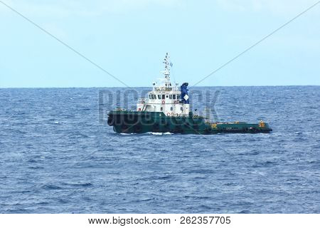 Supply Boat Transfer Cargo To Oil And Gas Industry And Moving Cargo From The Boat To The Platform. B