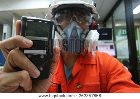 Multi-purpose Respirator Half Mask For Toxic Gas Protection.the Man Prepare To Wear Multi-purpose Ha