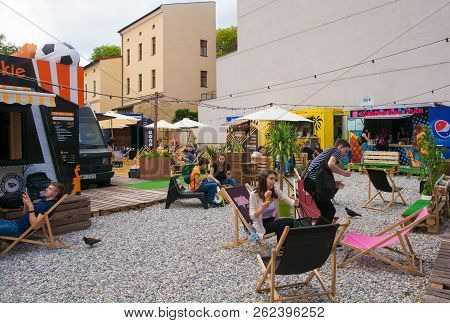 Krakow, Poland - July 12th 2018. Young People Relax And Eat Ice Cream At The Dworek Street Food Park