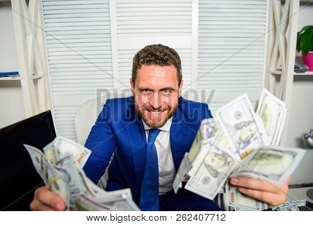 Earn Money Easy Business Tips. Man Cheerful Happy Businessman With Pile Dollar Banknotes. Profit And