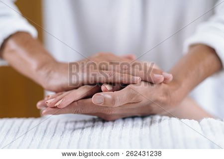 Holding Hands At Reiki Healing Treatment