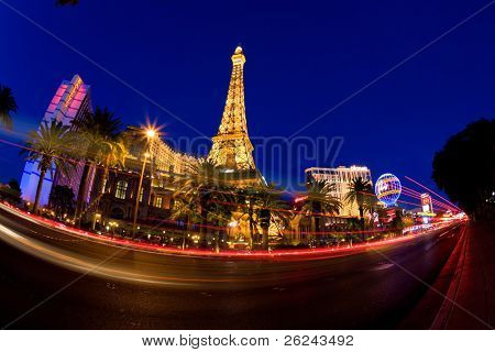 LAS VEGAS, NV - MAY 20:  Night street scene with colorful lights featuring Paris and Bally's hotels and casinos on May 20, 2010 in Las Vegas, NV.