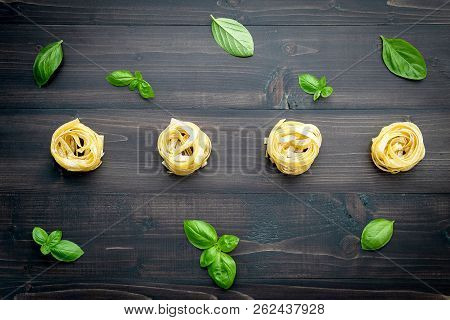 Ingredients For Homemade Pasta On Dark Wooden Background.