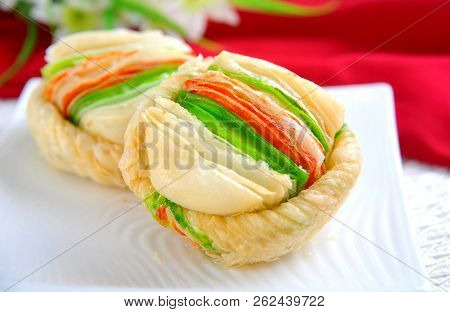 Malai Khaja, khoya or cream filled inside, sweet and crusty outside. poster