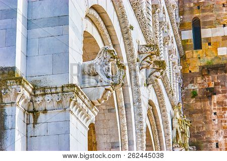 The Beautiful Carved Marble Sculptures On The Frontage Of Sam Martin Of Tours Cathedral In Lucca, It