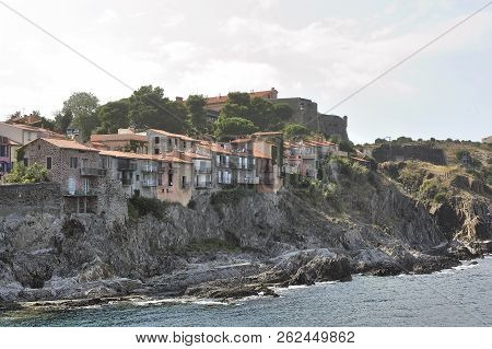 A Glimpse Of The Town Of Collioure With Its Old Houses At The Edge Of The Rocks And The Sea