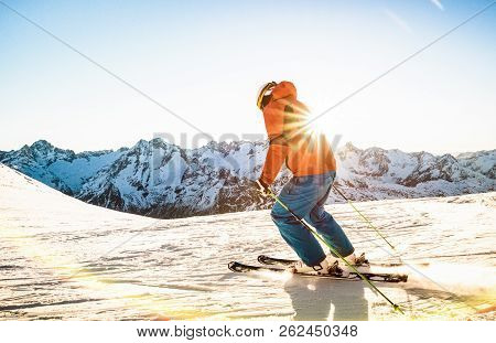 Professional Skier Athlete Skiing At Sunset On Top Of French Alps Ski Resort - Winter Vacation And S