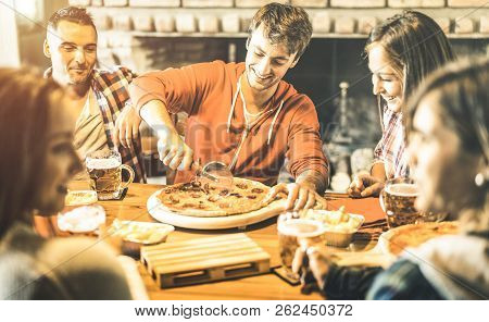 Happy Friends Group Eating Pizza At Chalet Bar Restaurant - Friendship Concept With Young People Enj