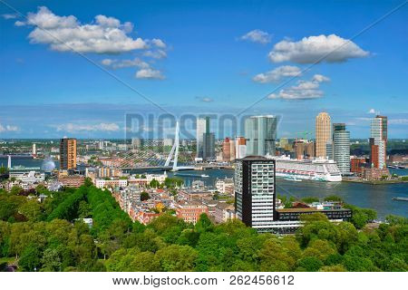 ROTTERDAM , NETHERLANDS - MAY 14, 2017: View of Rotterdam city and the Erasmus bridge Erasmusbrug over Nieuwe Maas river with cruise liner from Euromast
