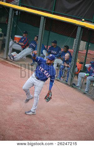 Sammy Sosa makes a play for the Texas Rangers in Cincinnati's Great American Ballpark