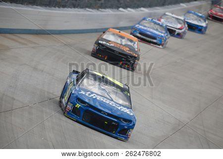 October 07, 2018 - Dover, Delaware, USA: William Byron (24) battles for position during the Gander Outdoors 400 at Dover International Speedway in Dover, Delaware.
