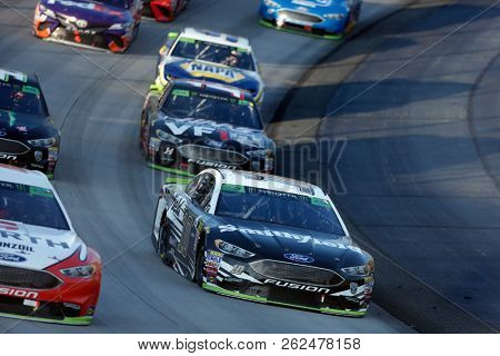 October 07, 2018 - Dover, Delaware, USA: Aric Almirola (10) races through the field off turn two at  the Gander Outdoors 400 at Dover International Speedway in Dover, Delaware.