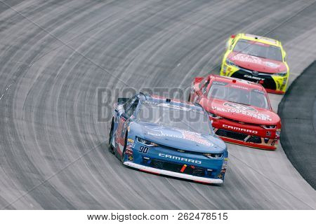 October 06, 2018 - Dover, Delaware, USA: Brandon Brown (90)  races through the field at the Bar Harbor 200 at Dover International Speedway in Dover, Delaware.
