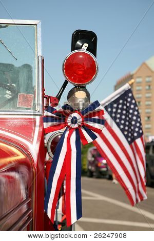 American patriotism displayed on a car before a Fourth of July parade