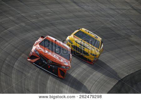 October 07, 2018 - Dover, Delaware, USA: Daniel Suarez (19) battles for position during the Gander Outdoors 400 at Dover International Speedway in Dover, Delaware.
