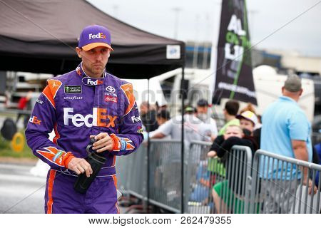 October 05, 2018 - Dover, Delaware, USA: Denny Hamlin (11) hangs out in the garage during practice for the Gander Outdoors 400 at Dover International Speedway in Dover, Delaware.