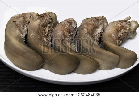 Raw Pork Or Beef Tongues On Black Wooden, Gourment Food Conception