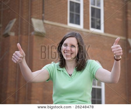 Attractive college student gives thumbs up