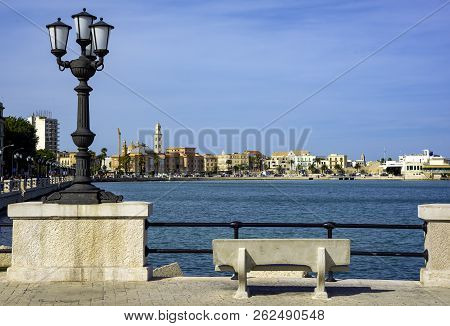 Panoramic Views Of The Waterfront Of Bari, Puglia - Italy In The Foreground The Characteristic Lampp