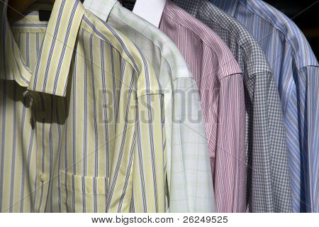 Selection of casual men's shirts on hangers