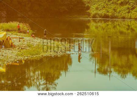 Daejeon, South Korea; September 23, 2018: Unidentified Koreans Relaxing On Rocky Shore Of River On F