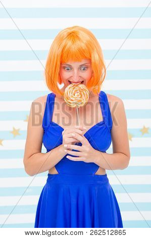 Crazy Girl In Playful Mood. Happy Pinup Model With Lollipop In Hand. Fashion Girl With Orange Hair H