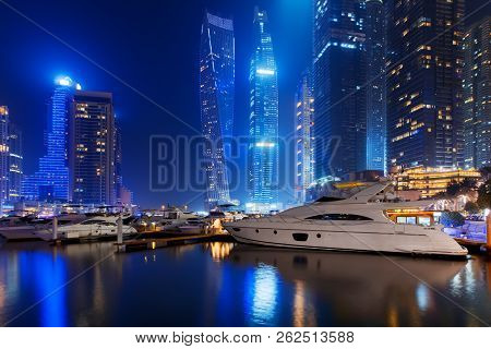 Beautiful View To Dubai Marina, Uae. Luxury Yachts At Pier. Long Exposure Time Lapse Effect At Night