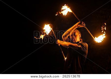 Fire Show. Fakir Dances With Two Staff. Night Performance. Dramatic Portrait