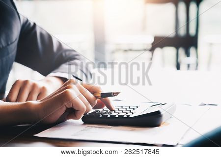 Businessman Analyzing Investment Charts With Calculator Laptop Calculate Technology In Office,busine