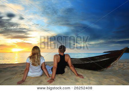 Romantic couple at uninhabited island at sunset time