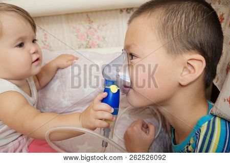 sick children - baby girl and boy use nebulizer mask for inhalation, respiratory procedure by pneumonia or cough for child, inhaler, compressor nebulizer, nebules machine for health care poster