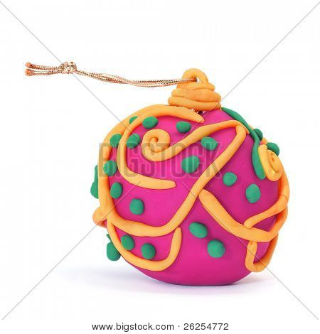 a colorful christmas ball made with modelling clay on a white background