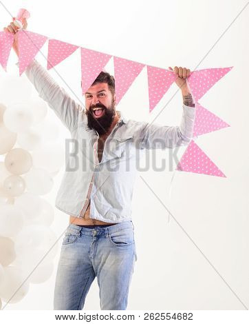 Man Bearded Hipster With Flag Garland Celebrate Birthday. Birthday Party Supplies. Guy Cheerful Mood