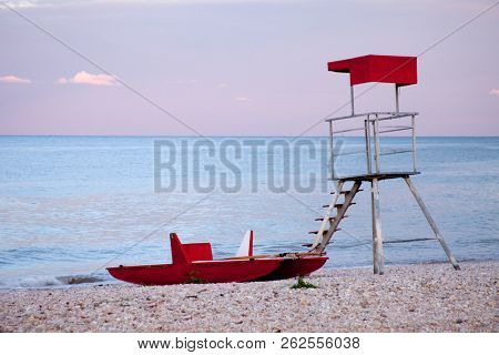 abandoned lifeguard tower and boat - landscape exterior