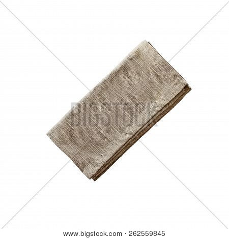 Folded Linen Napkin Isolated Over A White Background With Clipping Path Included. Image Shot From Ov