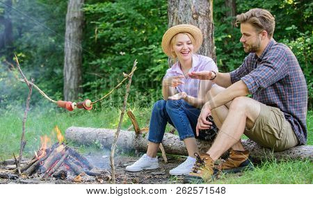 Couple Tourists Throwing Their Gesture While Sit Log Near Bonfire. Hand Gesture Game Decide Who Win.