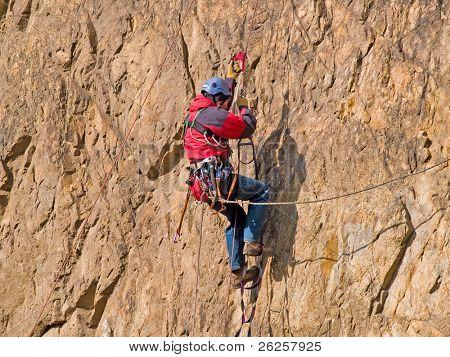climber swarming up the rock